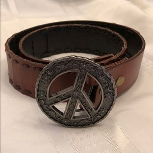 Accessories - Leather belt with peace sign buckle.
